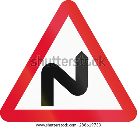 Hong Kong sign warning about a double curve first to right. - stock photo