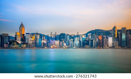 Hong Kong skyline in the evening over Victoria Harbour - stock photo