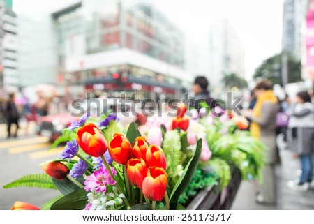 hong kong streets. concept about traveling. focus on the flower with all the scene blurred - stock photo