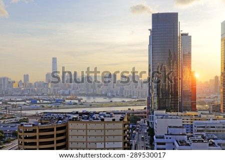 Hong Kong Sunset, View from kowloon bay downtown - stock photo
