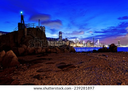 Hong Kong Sunset, Yau Tong Lei Yue Mun water bay and lighthouse  - stock photo