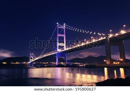 Hong Kong Tsing Ma Bridge at night - stock photo