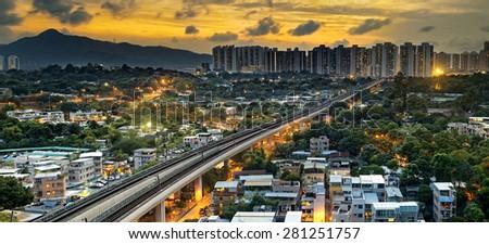 hong kong urban downtown and sunset speed train, Long Ping - stock photo