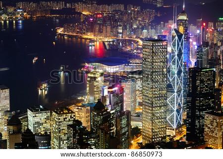 Hong Kong Victoria Harbour at night (aerial) - stock photo