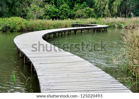 Hong Kong Wetland Park wooden walk way - stock photo