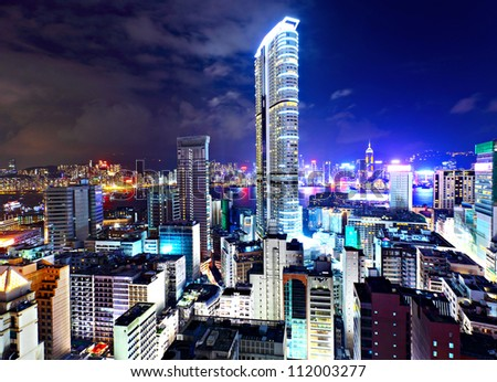 Hong Kong with crowded buildings at night - stock photo
