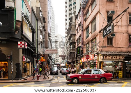 HONGKONG , CHINA-JULY 7 : Lifestyles of Hong Kong popular walking and taxi service. Because space is limited, so the city seemed more crowded dwellings. at Matheson Street on July 7,2014 in Hong Kong - stock photo