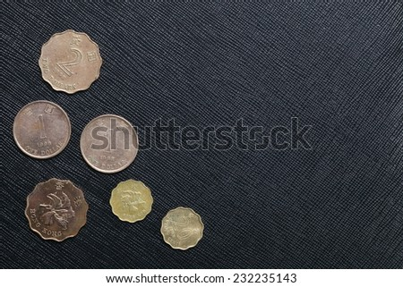 Hongkong dollar coin put on the black color leather surface as a background represent the finance currency. - stock photo