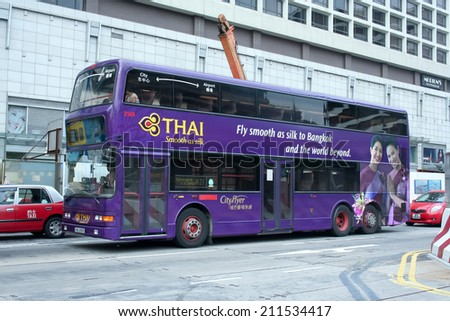 HONGKONG - OCTOBER 4 2007: Cityflyer bus between city and airport route. Thaiairway paint on side bus. Photo at road to Aiport, Hongkong, China. - stock photo