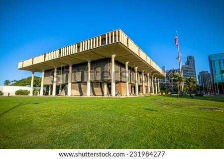HONOLULU, APRIL 23, 2013: Hawaii State Capital Building at sunrise, APRIL 23, 2013, HONOLULU, HAWAII, USA. Title:  Hawaii State Capitol Building - stock photo