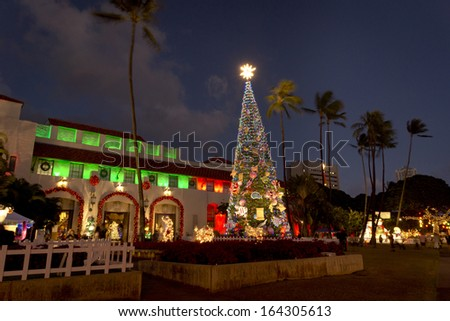 HONOLULU - DECEMBER 20, 2012: Honolulu City Lights runs throughout the month of December, and features a 50-foot Norfolk pine Christmas tree, giant Yuletide displays and live entertainment. - stock photo