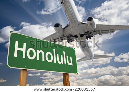 Honolulu Green Road Sign and Airplane Above with Dramatic Blue Sky and Clouds. - stock photo