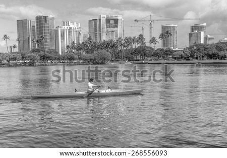 Honolulu,Hawaii,USA, April 12, 2015:  A solo outrigger canoe practices for the upcoming Hawaii State Outrigger Canoe Regatta.  Honolulu is the world center for outrigger canoe racing. - stock photo