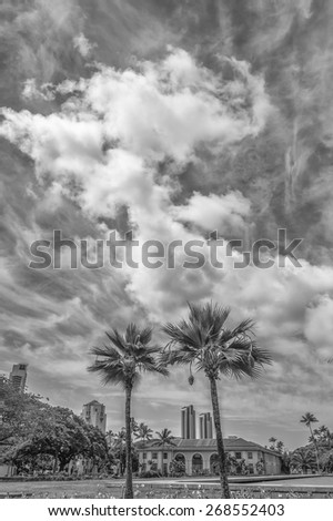 Honolulu, Hawaii, USA, April 12, 2015: Cityscape view of Honolulu City Hall, also known as Honolulu Hale, from the Hawaii State Legislature Building great lawn. - stock photo