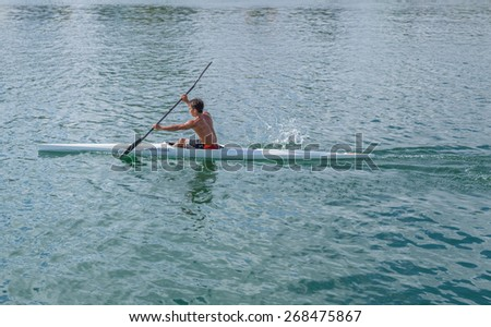 Honolulu, Hawaii, USA, April 12, 2015:  Hawaii State Solo Kayak Championships are set to begin in June as this competitor practices at The State of Hawaii Ala Wai Harbor in Waikiki. - stock photo