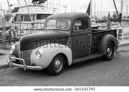 Honolulu, Hawaii, USA, Jan. 21, 2016:  Antique pickup truck still in daily use in Waikiki. Old cars and trucks are popular in the Hawaiian Islands. - stock photo
