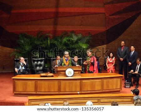 HONOLULU, HI - JANUARY 14: Former U.S. Sen. Daniel Akaka sings as he accepts award became the first recipient of the Aloha Order of Merit award January 14 2013 at the State Capitol in Honolulu, Hawaii - stock photo