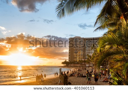 HONOLULU, HI - MAR 15 - Tourists enjoying Waikiki Beach at sunset on March 15, 2016 in Oahu. Waikiki beach is beachfront neighborhood of Honolulu, well known for tourism and surfing. - stock photo