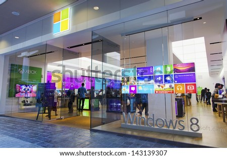 HONOLULU - JUNE 20: The new Microsoft Store in Honolulu launched on June 12, 2013.  This store is unique because of its placement across from the Apple Store. - stock photo