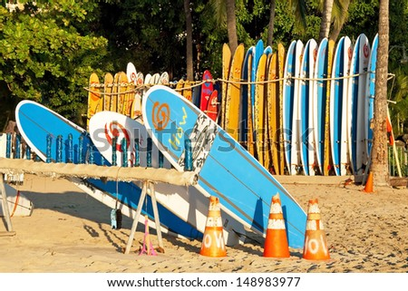 HONOLULU, USA - SEPTEMBER 24: Surf rental shop on Waikiki beach on September 24, 2011 in Honolulu, Usa. Waikiki beach is neighborhood of Honolulu, best known for white sand and surfing. - stock photo