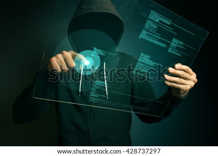 Hooded computer hacker using biometric security internet system, fingerprint identification app on futuristic tablet computer device,  - stock photo