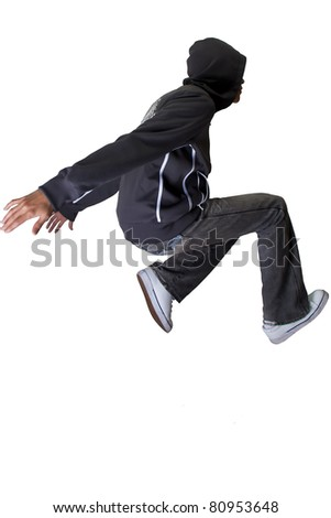 hooded free-runner jumping isolated on white background - stock photo