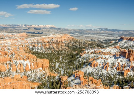 Hoodoos, canyon walls, fins, trees, and snow at a view point from Inspiration Point in Bryce Canyon National Park. - stock photo