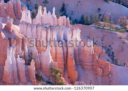 Hoodoos of Bryce Canyon national park at sunrise - stock photo