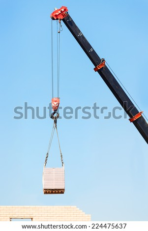 Hook cargo crane on the sky background - stock photo