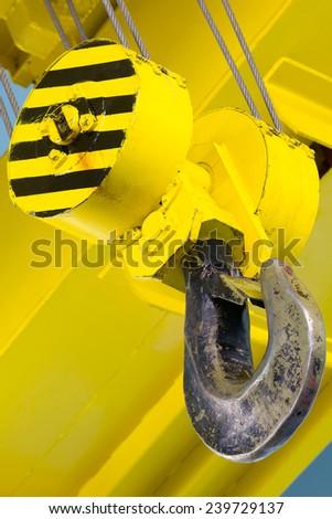 Hook of a heavy duty overhead crane - stock photo
