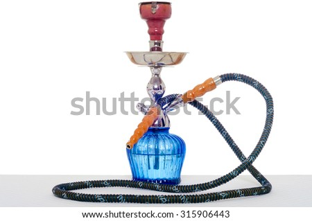 Hookah at white background. Smoking device on table in light interior. - stock photo