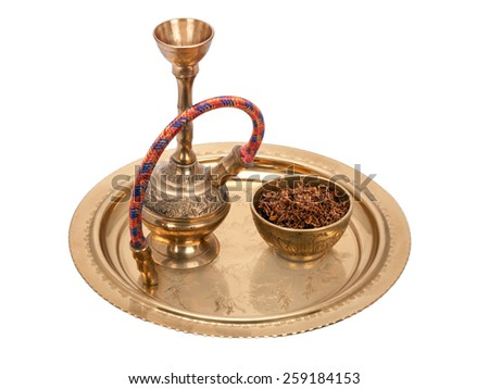 Hookah l and bowl with tobacco on a round bronze tray - stock photo