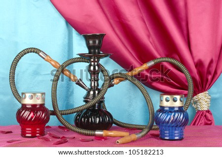 hookah on a wooden table on a background of curtain close-up - stock photo