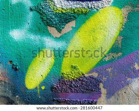 Hooligan smeared paint the walls of the old building. Landscape style. Grungy concrete surface with cracks, scratches and streaks of paint. Great background or texture. - stock photo