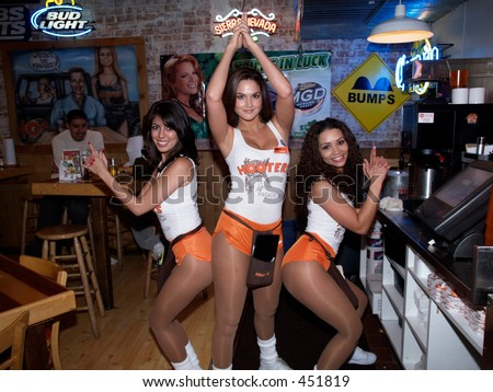 Hooters girls posing as Charlie's Angels - stock photo