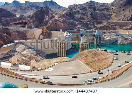 Hoover Dam and its penstock towers in Lake Mead in the Black Canyon of the Colorado River on the border of Arizona and Nevada Taken in 2007 - stock photo