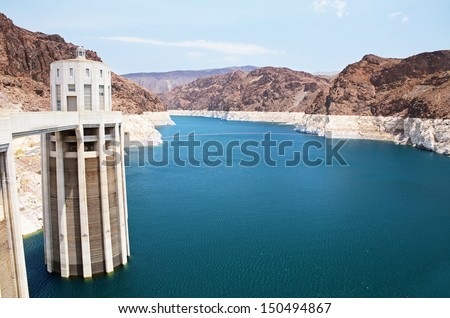 Hoover Dam - concrete arch-gravity dam in the Black Canyon of the Colorado River, on the border between the US states of Arizona and Nevada - stock photo