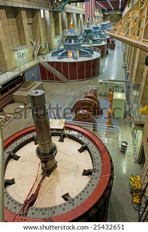 Hoover dam generators with rarely seen rotor in foreground. Last time rotor was removed was 45 years ago - stock photo