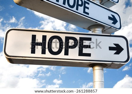Hope direction sign on sky background - stock photo