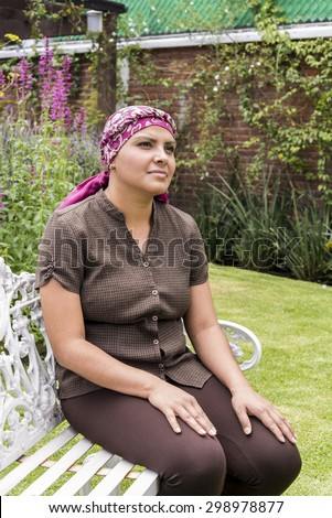 Hope expression in a Latin cancer patient This beautiful woman is under chemotherapy treatment to cure breast cancer - stock photo