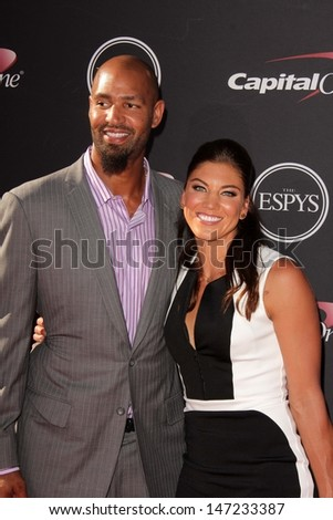 Hope Solo and Jerramy Stevens at The 2013 ESPY Awards, Nokia Theatre L.A. Live, Los Angeles, CA 07-17-13 - stock photo