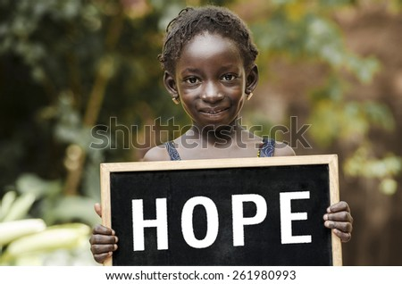 "Hope Symbol - Teenage Girl Holding Chalkboard Helping Hand. A girl holding a chalkboard with ""HOPE"" written on it. - stock photo"