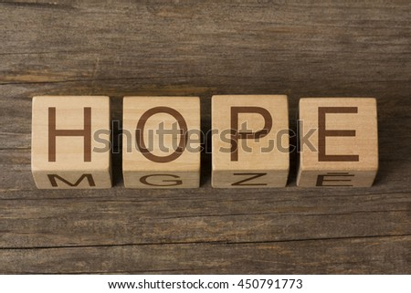 HOPE word on wooden cubes - stock photo