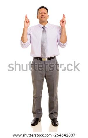 hopeful mid age man with fingers crossed isolated on white background - stock photo