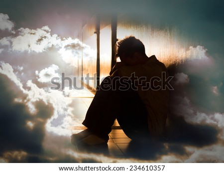 Hopeless man on surreal dramatic sky background. - stock photo