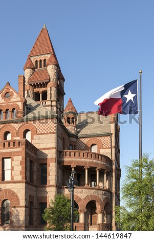 Hopkins County Texas Courthouse in Sulphur Springs Texas with Texas Flag - stock photo