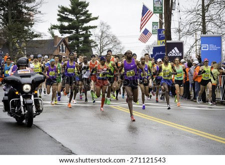 HOPKINTON, USA - APRIL 20: Elite male athletes competing in the Boston Marathon 2015 a few seconds after the start of the race in Hopkinton, Massachusetts, USA on April 20, 2015. - stock photo