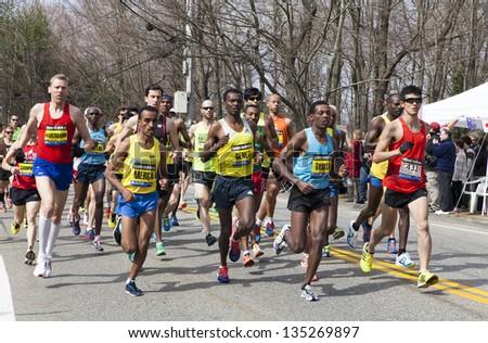 HOPKINTON, USA - APRIL 15: Elite Men Wave One right after the start of the Boston Marathon 2013 in Hopkinton heading to the finishing line Boston in Massachusetts, USA on April 15, 2013. - stock photo