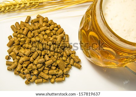 Hops pellets with beer glass - stock photo