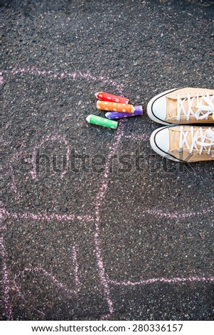 Hopscotch on the ground on asphalt with colorful street chalk - stock photo